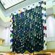 (写真)巨大な幕の一部をまくり上げる形に変更し、「不自由展」中止に抗議したピア・カミル氏の作品=20日、名古屋市東区