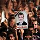 エジプトのモルシ元大統領死去、公判中に法廷で倒れる