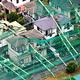 ゴルフ練習場のネットが倒れ、支柱が住宅を直撃した=2019年9月9日午前9時13分、千葉県市原市、朝日新聞社ヘリから、迫和義撮影