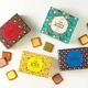 さまざまな味わいのチョコレートを色とりどりのラング・ド・シャでサンドした、サク ラング・ド・シャ12枚入り(1種×12枚、各1296円〜)/ISHIYA SHINSAIBASHI