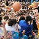 今年の成人式で、ミッキーと手を合わせる新成人たち=2020年1月13日午前10時13分、東京ディズニーランド、三嶋伸一撮影