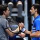 男子テニス、ATPワールドツアー・ファイナルズ3日目。試合を終え、握手を交わすノバク・ジョコビッチ(右)とドミニク・ティエム(2019年11月12日撮影)。(c)Glyn KIRK / AFP