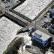 台風19号による大雨で決壊した堤防=2019年10月13日午前9時46分、栃木県佐野市、朝日新聞社ヘリから、仙波理撮影