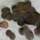 高熱で一部が変形して固まった銅貨=林一茂撮影