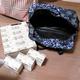 現金1億3千万円が入ったバッグも見つかった=大阪国税局提供