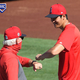 ANAHEIM, CA - JULY 30: Shohei Ohtani #17 and manager Joe Maddon #70 of the Los Angeles Angels bump elbows after batting practice for the game against the Seattle Mariners at Angel Stadium of Anaheim on July 30, 2020 in Anaheim, California. (Photo by Jayne Kamin-Oncea/Getty Images)