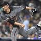 SAN DIEGO, CA - SEPTEMBER 21: Yoshihisa Hirano #66 of the Arizona Diamondbacks pitches during the seventh inning of a baseball game against the San Diego Padres at Petco Park September 21, 2019 in San Diego, California. (Photo by Denis Poroy/Getty Images)