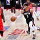 NBAジャパンゲームス、ヒューストン・ロケッツ対トロント・ラプターズ。ドリブルするヒューストン・ロケッツのラッセル・ウェストブルック(右、2019年10月10日撮影)。(c)TOSHIFUMI KITAMURA / AFP