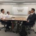 協議に臨む両国の関係者=12日、東京(共同取材団=聯合ニュー
