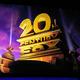 昨年4月、20世紀フォックスの映画のポスター画像を背景にプレゼンするディズニー幹部=AP
