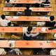 初の大学入学共通テストを迎え、試験前に解答用紙を受け取る受験生ら。新型コロナウイルス対策として使用しない席には赤いバツ印が付けられ距離が保たれていた=東京都文京区の東京大学で2021年1月16日午前9時17分、北山夏帆撮影