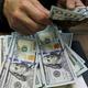 正午のドルは108円前半、FOMC控えたポジション調整