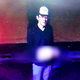事件が起きた吹田署千里山交番の防犯カメラに映った不審な男の画像。16日午前4時16分に撮影された。捜査への影響から手元の部分は加工されている(大阪府警提供)