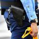 警察官が腰に携帯している拳銃=2019年6月16日午前、大阪府吹田市、遠藤真梨撮影