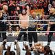 ルーク・ギャローズ、AJスタイルズ、カール・アンダーソンは勝ち名乗りを上げた(左から)。下は敗れたリコシェ(C)2019 WWE, Inc. All Rights Reserved.