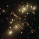 強力な「重力レンズ」の効果。銀河団の重力に歪められた遠くの銀河の像