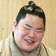 一夜明けのオンライン会見で笑顔を見せる大栄翔(日本相撲協会提供)