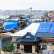 千葉県館山市の布良地区では、多くの家屋の屋根がブルーシートで覆われていた=2019年9月14日午後4時56分、今泉奏撮影