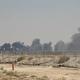 サウジアラビア東部のアブカイクで、無人機(ドローン)による攻撃を受けた国営石油会社サウジ・アラムコの施設から上がる黒煙(2019年9月14日撮影)。(c)AFP=時事/AFPBB News
