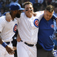 CHICAGO, ILLINOIS - SEPTEMBER 15: Anthony Rizzo of the Chicago Cubs is helped off the field by Jason Heyward (L) and trainer PJ Mainville after being injured against the Pittsburgh Pirates during the third inning at Wrigley Field on September 15, 2019 in Chicago, Illinois. (Photo by David Banks/Getty Images)