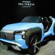 ガスタービンエンジンを搭載するプラグインハイブリッド車の試作車。三菱自動車が初公開した=23日、東京都江東区