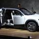 マツダが発表したハイブリッド車「MX−30」。前後ドアが観音開きになる=23日午前、東京都江東区の東京ビッグサイト(佐藤徳昭撮影)