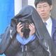 2008年11月、送検される中勝美容疑者