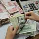 中国当局の元高官はこのほど、ドルと人民元の切り離しに言及した(AFP/Getty Images)