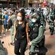 警察官に連行されるデモ参加者の女性(中央)=2020年7月1日、香港、益満雄一郎撮影