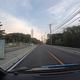 7/4日本原電東海第二発電所入り口付近(GoPro画像より) 正面の交差点から左に入ると原電私有地となる。すでに19時を過ぎており、展示館は閉館時間後のため入構しなかった。