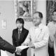 (写真)道国保連合会(左)に要請する被災3町の党議員と畠山氏(右から2人目)=19日、札幌市