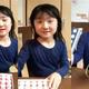 行方不明になっている小倉美咲さんの家族が公開した美咲さんの動画から。今年6月ごろ撮影され、その後、髪を切ったが全体の印象はそのままだという