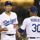 LOS ANGELES, CA - SEPTEMBER 21: Manager Dave Roberts #30 of the Los Angeles Dodgers comes in to pull Kenta Maeda #18 from the game in the ninth inning against the Colorado Rockies at Dodger Stadium on September 21, 2019 in Los Angeles, California. (Photo by John McCoy/Getty Images)