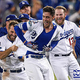 LOS ANGELES, CA - OCTOBER 16: Cody Bellinger #35 of the Los Angeles Dodgers celebrates with teammates after hitting a walk-off single in the thirteenth inning against the Milwaukee Brewers to win Game Four of the National League Championship Series 2-1 at Dodger Stadium on October 16, 2018 in Los Angeles, California. (Photo by Kevork Djansezian/Getty Images)