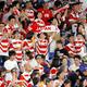 横浜国際総合競技場で13日、スコットランド戦での日本の勝利を喜ぶファンたち=ロイター。対戦国のメディアも、その熱い声援を警戒する