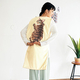 フェリシモ、猫が飼い主におんぶされたデザインの防寒具「ねこ」を発売