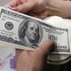 正午のドルは107円半ば、5カ月半ぶり安値
