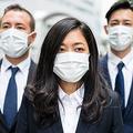 マスクを着けた日本のビジネスパーソン