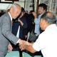 選挙前の事務所開きで支援者と握手する谷川弥一氏=2017年10月6日、長崎県大村市