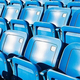 Empty blue seating in sports stadium