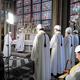 パリで15日、ノートルダム大聖堂での火災後初となるミサに臨む司教ら=ロイター