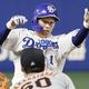 9回中日二死三塁、京田が右中間に適時二塁打を放ち、三塁を狙うがタッチアウトで試合終了。三塁手若林=ナゴヤドーム(C)Kyodo News
