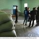 コロナ禍前に北朝鮮の配給所を訪れた国際機関の共同調査団(資料写真、FAO・WFP提供)=(聯合ニュース)≪転載・転用禁止≫