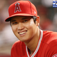 PHOENIX, AZ - AUGUST 21: Shohei Ohtani #17 of the Los Angeles Angels smiles in the dugout before the start of the MLB game against the Arizona Diamondbacks at Chase Field on August 21, 2018 in Phoenix, Arizona. (Photo by Christian Petersen/Getty Images)