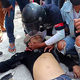 28日、ミャンマー南部ダウェーで、抗議デモに参加中に銃撃を受けた男性=「ダウェー・ウォッチ」提供のビデオ映像から(AFP時事)