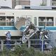 小田急の列車と衝突し、大破した車=19日午後、神奈川県厚木市